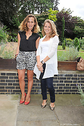 Left to right, CHARLOTTE DELLAL and LYDIA FORTE at an Indian Tea Party for fashion label Saloni, held at The Coach House, Debenham House, 8 Addison Road, London W14 on 14th July 2009.