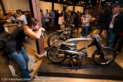 Photographing Shinya Kimura's little bike entry durint the Friday night opening of the Handbuilt Motorcycle Show. Austin, TX. April 10, 2015.  Photography ©2015 Michael Lichter.