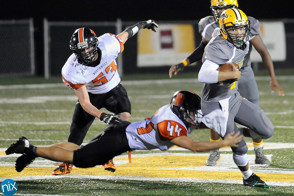 Vikings quarterback Tyler English (7, right) breaks this tackle by Trojans linebacker Riles Aigner (44, left) during the Northwest Cabarrus Trojans at Central Cabarrus Vikings high school football game on Friday night.