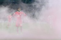 Football - 2018 / 2019 UEFA Nations League B - Group Four: Wales vs. Denmark<br /> <br /> Tyler Roberts of Wales behind red smoke from a flare thrown on to the pitch , at Cardiff City Stadium.<br /> <br /> COLORSPORT/WINSTON BYNORTH