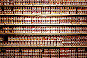 Rows of Campbell's soup cans line the shelves at Raley's, a California grocery chain. Hungry Planet: What the World Eats (endpapers).