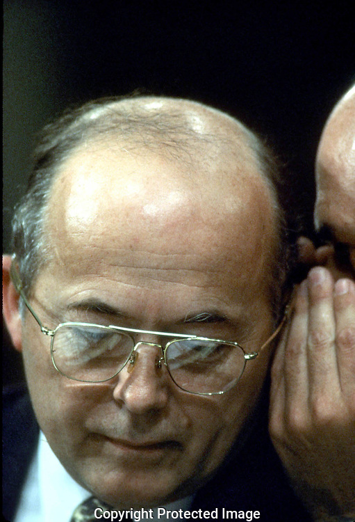 A 28.8 MG FILE FROM FILM OF:..John Poindexter receiving advice from his attorney during a House of Representatives hearing on Iran Contra. Photo by Dennis Brack