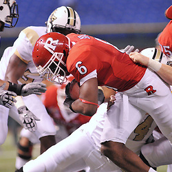 Dec 19, 2009; St. Petersburg, Fla., USA; Rutgers wide receiver Mohamed Sanu (6) runs through a tackle attempt during NCAA Football action in Rutgers' 45-24 victory over Central Florida in the St. Petersburg Bowl at Tropicana Field.