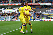 Alex Mowatt of Leeds united (c) gets a lift from teammates Gaetano Berardi (28) and Chris Wood (9) as he celebrates after scoring his teams 3rd goal. Skybet football league Championship match, Huddersfield Town v Leeds United at the John Smith's Stadium in Huddersfield, Yorks on Saturday 7th November 2015.<br /> pic by Chris Stading, Andrew Orchard sports photography.