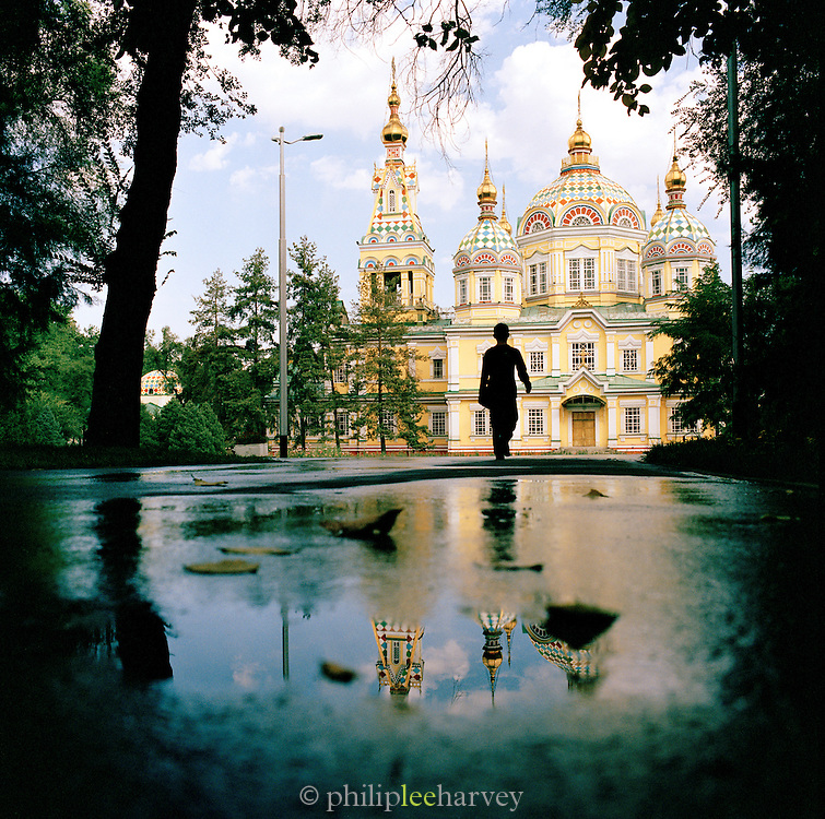 Local walking in front of the Zenkov Cathedral in Almaty, Kazakhstan.Asia.