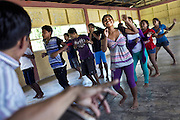 School children learning traditional Shipibo dances.<br /> Alianza Arkana has implemented a pilot program establishing an intercultural school in Puerto Firmeza, a Shipibo community near Pucallpa. The vision of the program is to create a truly intercultural education, interweaving Western education – critical for survival in a rapidly globalizing world – and traditional indigenous knowledge. <br /> With highly motivated teachers and a creative, student-focused curriculum, we aim to increase attendance at school, improve educational quality and relevance, strengthen cultural identity, and empower indigenous youth from an early age.