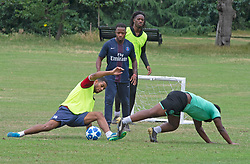 ©Licensed to London News Pictures 02/07/2020     <br /> Greenwich, UK. Footballers training with no real social distancing. Greenwich Park, Greenwich, London today as the Coronavirus lockdown is eased. The weather continues to be unsettled with heavy rain and sunshine. Photo credit: Grant Falvey/LNP