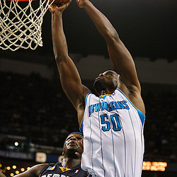 January 19, 2011; New Orleans, LA, USA; New Orleans Hornets center Emeka Okafor (50) shoots over Memphis Grizzlies power forward Zach Randolph (50) during the third quarter at the New Orleans Arena. The Hornets defeated the Grizzlies 130-102 in overtime.  Mandatory Credit: Derick E. Hingle