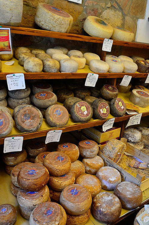 Cheese on display at a shop in Pienza, Italy.