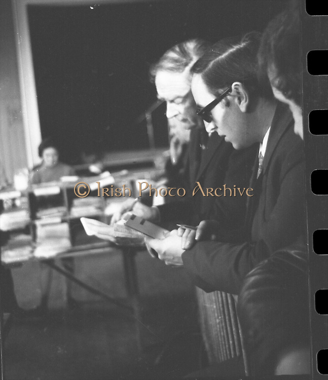 Mr Liam Cosgrave,Leader of Fine Gael,at Vote Count. (E48).1973..01.03.1971..03.01.1973..1st March 1973..As the ballot boxes were opened in Dun Laoghaire Town Hall, Mr Cosgrave and his supporters watched as the voting papers were piled high. The vote was as the result of an often hectic General Election campaign. Mr Cosgrave was hoping his party would garner enough votes to oust the sitting Fianna Fail Government which had held power for sixteen years...Picture of a tallyman,alongside Mr Liam Cosgrave, assessing the impact of the votes on the outcome of the general election.