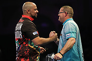 Devon Peterson and Steve West at the end of their third round match during the World Darts Championships 2018 at Alexandra Palace, London, United Kingdom on 27 December 2018.