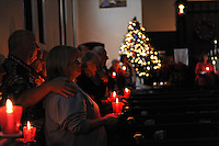 Parishioners at a candlelight Christmas Eve service at the United Methodist Church in Salinas.