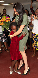 The Duchess of Sussex is presented flowers by Luyanda, eight , as she visits Action Aid, a gender based violence education club in Johannesburg, South Africa, on day nine of her tour of Africa.