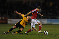 Wrexham's Adrian Cieslewicz ® holds off Newport's David Pipe. Blue Square Bet Premier division, Newport County FC v Wrexham at Rodney Parade in Newport, South Wales on Friday 4th Jan 2013. pic by Andrew Orchard, Andrew Orchard sports photography,
