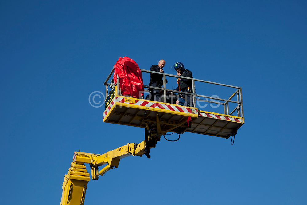 Cherry picker removes two protesters. Protesters who barricaded themselves above the entrance to the Dale Farm travellers' site have been removed by police as bailiffs prepare to move in. Essex Police cleared the scaffolding structure so it could be dismantled and machinery driven in by bailiffs to evict the travellers. On Wednesday night Essex Police said that over the course of the day 23 people had been arrested. Clearance of Dale Farm prior to eviction. Riot police and bailiffs were present on 19th October 2011, as a scaffolding gantry was cleared of protesters so the site could be cleared. Dale Farm is part of a Romany Gypsy and Irish Traveller site on Oak Lane in Crays Hill, Essex, United Kingdom. Dale Farm housed over 1,000 people, the largest Traveller concentration in the UK. The whole of the site is owned by residents and is located within the Green Belt. It is in two parts: in one, residents constructed buildings with planning permission to do so; in the other, residents were refused planning permission due to the green belt policy, and built on the site anyway.