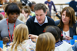 © Licensed to London News Pictures. 03/11/2014. LONDON, UK. Lorraine Pascale, The Deputy Prime Minister Nick Clegg and Lynne Featherstone sit with school children over lunch at Weston Park Primary School in Crouch End, London on Monday 3 November 2014. Photo credit : Tolga Akmen/LNP