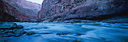 The Colorado River flowing over House Rock Rapid at dawn in Marble Canyon, Grand Canyon National Park, Arizona