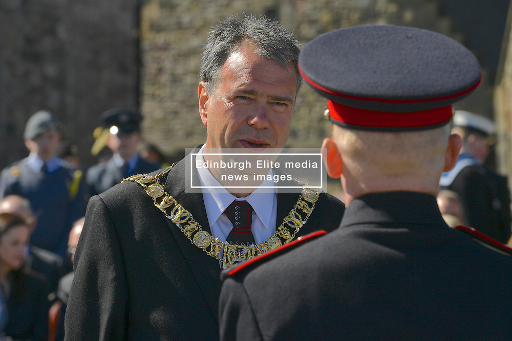 The Rt. Hon. Donald Wilson Lord Lieutenant and Lord Provost of the City of Edinburgh chats with soldiers form the Royal Artillery after 21-gun royal salutes to mark Queen's 90th birthday. At Edinburgh Castle, <br /> (c) Brian Anderson   Edinburgh Elite media