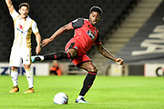 Grimsby Town striker JJ Hooper (9) takes a shot at goal  during the EFL Sky Bet League 2 match between Milton Keynes Dons and Grimsby Town FC at stadium:mk, Milton Keynes, England on 21 August 2018.