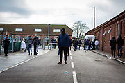 Asylum seekers held inside Napier Barracks head to a meeting with Home Office representatives after staging a peaceful protest outside the entrance to the barracks with banners and signs to demonstrate about the poor conditions they are subjected to inside the holding centre on the 12th of January 2021, Folkestone Kent. Over 400 asylum seekers are being kept at Napier Barracks in unsuitable, cold accommodation, they are experiencing mental health issues including several suicide attempts as well as being vulnerable to health conditions including COVID-19. (photo by Andy Aitchison)