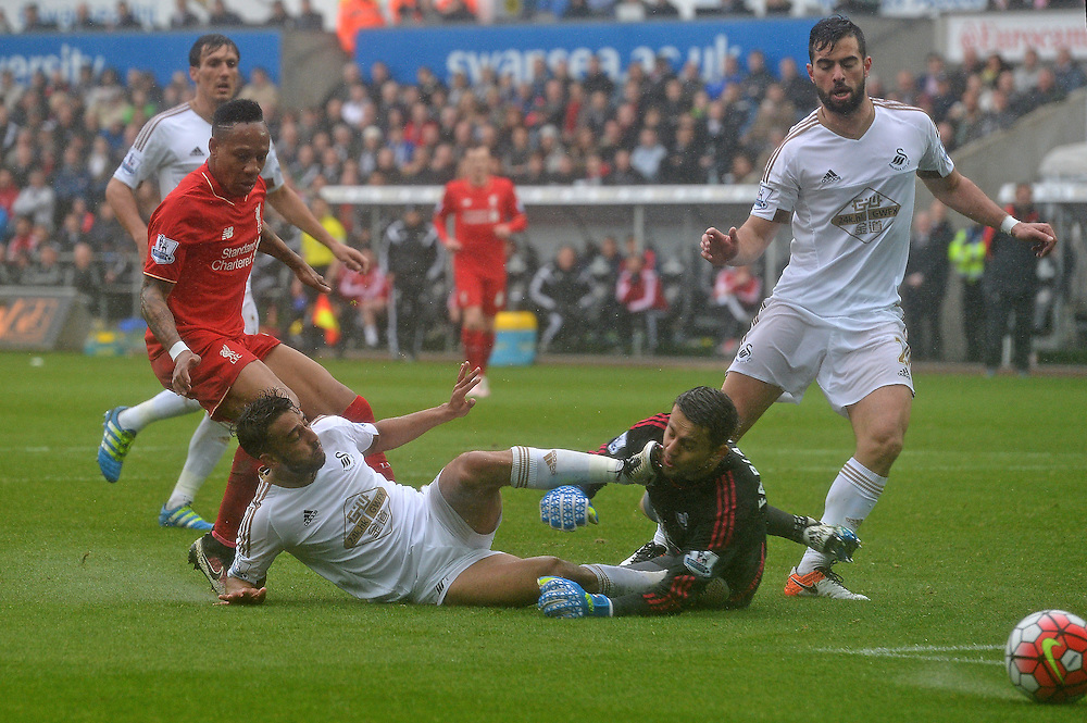Swansea City's Neil Taylor collides with his goal keeper Lukasz Fabianski<br /> <br /> Photographer Ian Cook/CameraSport<br /> <br /> Football - Barclays Premiership - Swansea City v Liverpool - Sunday 1st May 2016 - Liberty Stadium - Swansea<br /> <br /> © CameraSport - 43 Linden Ave. Countesthorpe. Leicester. England. LE8 5PG - Tel: +44 (0) 116 277 4147 - admin@camerasport.com - www.camerasport.com
