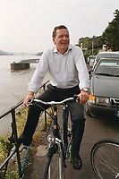 """16 JUL 1999 - DOLLENDORF, GERMANY:<br /> Gerhard Schröder, Bundeskanzler, mit Fahrrad, während der SPD Radtour """"Abschied vom Rhein""""<br /> Gerhard Schroeder, Fed. Chancellor Germany, with bike during a trip with a part of the SPD parliamentary group to a """"Goodbye from Rhine"""" tour <br /> IMAGE: 19990716-01/03-05"""