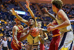 Mar 6, 2019; Morgantown, WV, USA; West Virginia Mountaineers forward Derek Culver (1) makes a move under the basket during the second half against the Iowa State Cyclones at WVU Coliseum. Mandatory Credit: Ben Queen-USA TODAY Sports
