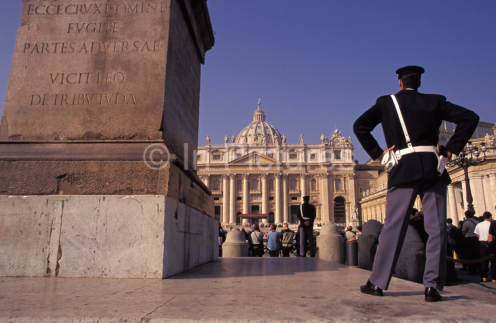 Two police officers keep watch over tourists in the centre outside the Vatican in St. Peters Square, on 3rd November 1999, in Rome Italy.