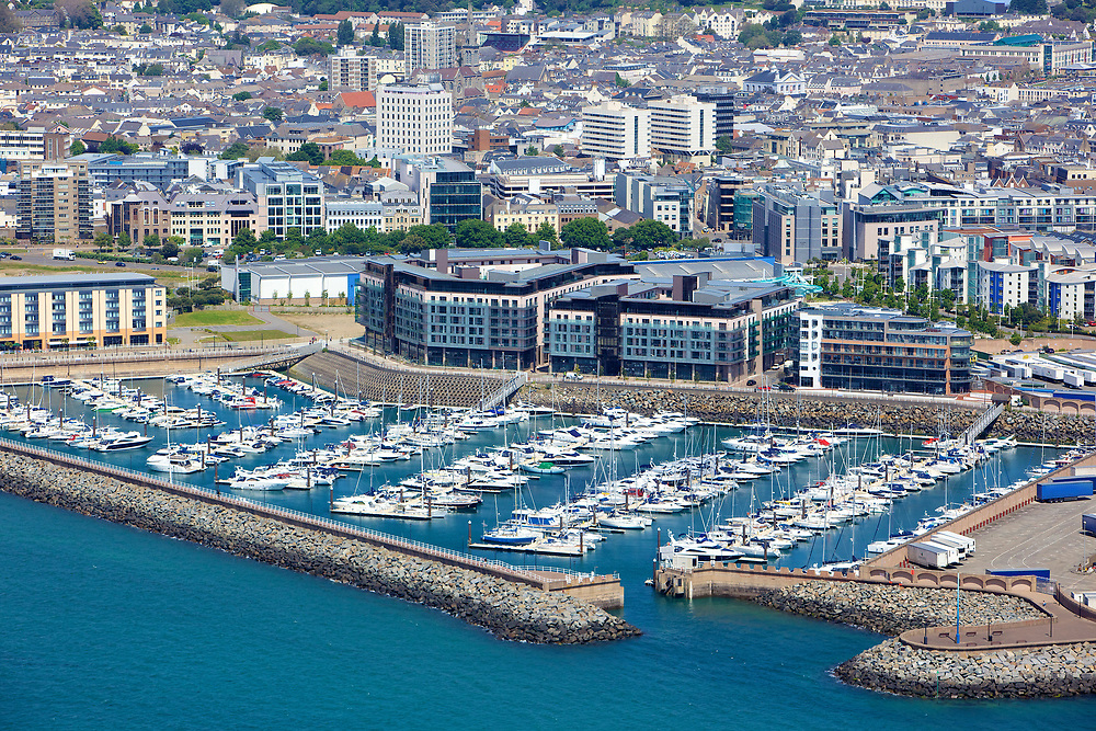 Aerial view of boats moored up at Elizabth Marina, Castle Quay and town in the distance in St Helier, Jersey, Channel Islands