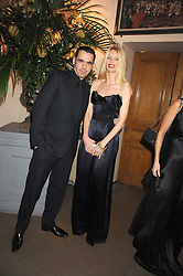 ROLAND MOURET and CLAUDIA SCHIFFER at Chaos Point - a fashion show from Viienne Westwood's Gold Label Collection in aid of the NSPCC at The Banqueting House, London SW1 on 18th November 2008.