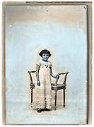 child standing with classic chair on a retouched glass plate France circa 1930s