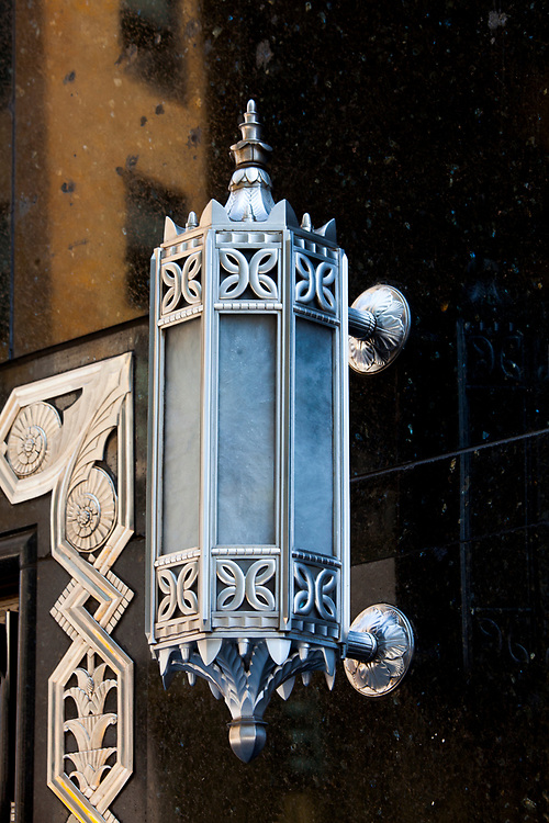 A splendid, Art Deco light fixture stands out against the black marble entrance to a Chase Bank branch on the Chrysler Building's Lexington Avenue facade.
