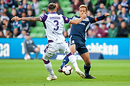 Perth Glory defender Jason Davidson (3) defends the ball from Melbourne Victory midfielder Keisuke Honda (4) at the Hyundai A-League Round 2 soccer match between Melbourne Victory and Perth Glory at AAMI Park in Melbourne.