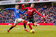 Alfredo Morelos lunges for the ball in the Kilmarnock penalty area during the Ladbrokes Scottish Premiership match between Rangers and Kilmarnock at Ibrox, Glasgow, Scotland on 16 March 2019.