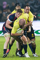 John Quill  (L) of USA tries to stop Mihaita Lazar (R) of Romania during their  rugby test match between Romania and USA, on National Stadium Arc de Triomphe in Bucharest, November 8, 2014.  Romania lose the match against USA, final score 17-27.