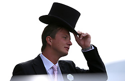 A racegoer tips his hat during day five of Royal Ascot at Ascot Racecourse.