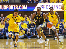 Dec 8, 2018; Morgantown, WV, USA; Pittsburgh Panthers guard Xavier Johnson (1) dribbles the ball during the first half against the West Virginia Mountaineers at WVU Coliseum. Mandatory Credit: Ben Queen-USA TODAY Sports