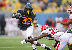 Sep 8, 2018; Morgantown, WV, USA; West Virginia Mountaineers running back Martell Pettaway (32) runs the ball during the second quarter against the Youngstown State Penguins at Mountaineer Field at Milan Puskar Stadium. Mandatory Credit: Ben Queen-USA TODAY Sports
