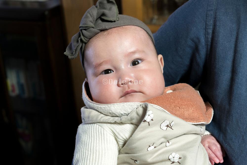 Japanese toddler baby looking at the camera