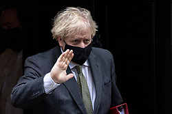 © Licensed to London News Pictures. 09/12/2020. London, UK. Prime Minister Boris Johnson leaves 10 Downing Street to attend parliament for Prime Minister's Questions.  The Prime Minister will travel to Brussels for a face-to-face meeting with President of the European Commission Ursula con der Leyen in a final attempt to find agreement on a possible Brexit deal. Photo credit: Rob Pinney/LNP