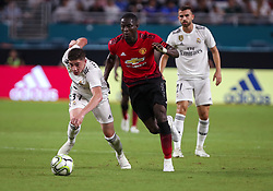 July 31, 2018 - Miami Gardens, Florida, USA - Real Madrid C.F. midfielder Federico Valverde (37) (left) moves the ball away from Manchester United F.C. defender Eric Bailly (3) (right) during an International Champions Cup match between Real Madrid C.F. and Manchester United F.C. at the Hard Rock Stadium in Miami Gardens, Florida. Manchester United F.C. won the game 2-1. (Credit Image: © Mario Houben via ZUMA Wire)