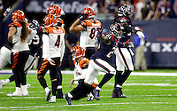 Houston Texans' A.J. Bouye (21) celebrates after Cincinnati Bengals kicker Randy Bullock (4) missed a field as time expired in an NFL football game Saturday, Dec. 24, 2016, in Houston. The Texans won 12-10. (AP Photo/Sam Craft)