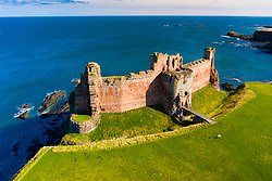 Aerial view of Tantallon Castle on sea cliffs coast in East Lothian Scotland UK