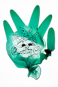 broken surgical glove with face drawing on it