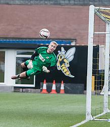 Alloa Athletic's keeper Scott Bain saves Falkirk's Phil Roberts shot.<br /> Alloa Athletic 0 v 0 Falkirk, Scottish Championship 12/10/2013. played at Recreation Park, Alloa.<br /> ©Michael Schofield.
