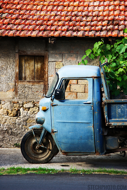 A blue Moto Guzzi Ercole beside a home in Fondi, Italy.<br /> <br /> + ART PRINTS +<br /> To order prints or cards of this image, visit:<br /> http://greg-stechishin.artistwebsites.com/featured/moto-guzzi-greg-stechishin.html