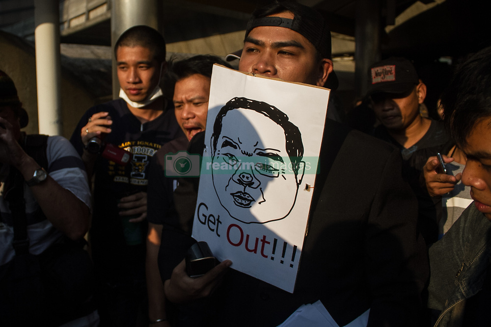 February 6, 2018 - Thailand - Thai political activists wear masks depicting Thai Deputy Prime Minister and Defense Minister General Prawit Wongsuwan with the message ' Get Out!!! ' and 'Friend's watch' (C), as they hold a symbolic protest at  SkyWalk Chong Nonsi in Bangkok during  recently Wongsuwan was caught up in a scandal over his high-end wristwatches. (Credit Image: © Vichan Poti/Pacific Press via ZUMA Wire)