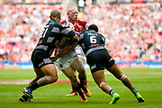 Wigan Warriors second row Liam Farrell (12) is tackled by Hull FC second row Sika Manu (21) and Hull FC stand off Albert Kelly (6)  during the Ladbrokes Challenge Cup Final 2017 match between Hull RFC and Wigan Warriors at Wembley Stadium, London, England on 26 August 2017. Photo by Simon Davies.