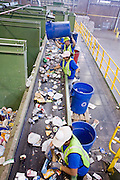 12 MARCH 2007 -- PHOENIX, AZ: Hudson Baylor employees sort recyclables at the new recycling center in the city of Phoenix, AZ. The center opened in February 2007 and is the most modern recyclables  processing center in the US. The center is operated by Hudson Baylor Corporation and processes about 1000 tonnes of recyclables a week.  Photo by Jack Kurtz/ZUMA Press