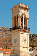 The port clock tower, Hydra,  Greek Saronic Islands .<br /> <br /> Visit our GREEK HISTORIC PLACES PHOTO COLLECTIONS for more photos to download or buy as wall art prints https://funkystock.photoshelter.com/gallery-collection/Pictures-Images-of-Greece-Photos-of-Greek-Historic-Landmark-Sites/C0000w6e8OkknEb8